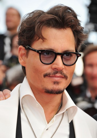 "CANNES, FRANCE - MAY 14: Actor Johnny Depp attends the ""Pirates of the Caribbean: On Stranger Tides"" premiere at the Palais des Festivals during the 64th Cannes Film Festival on May 14, 2011 in Cannes, France. (Photo by Pascal Le Segretain/Getty Images)"